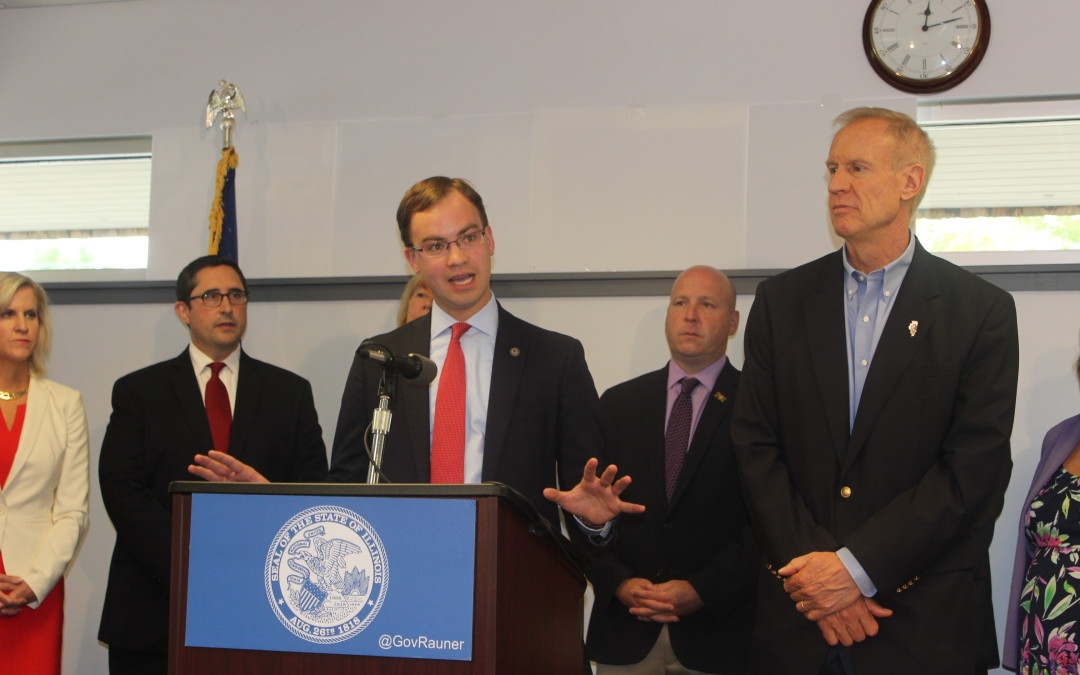 Representative David S. Olsen Joins Governor for Signing of Government Consolidation Bill